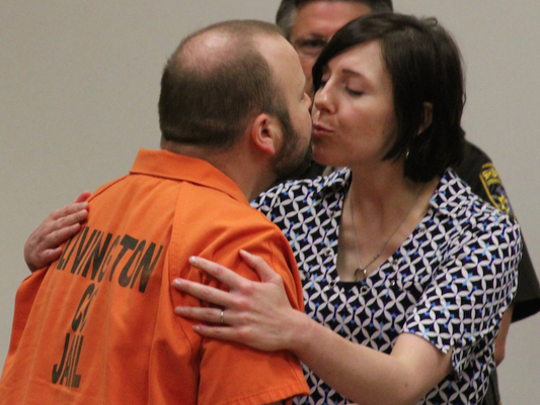 Joshua Burns, who is serving a county jail sentence for abusing his then-11-week-old daughter, embraced and shared a kiss today with his wife, Brenda Burns, after learning he will retain his parental rights to his daughter, Naomi. (Photo: Lisa Roose-Church/Livingston Daily)