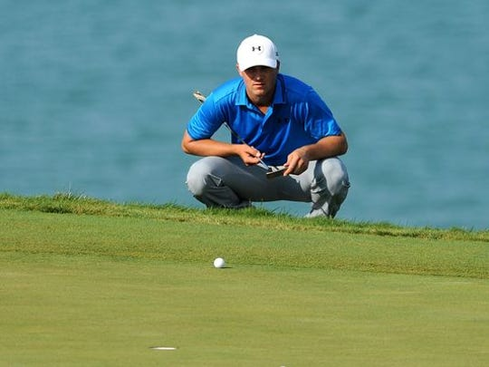 Jordan Spieth lines up his putt on the 13th green during the final round of the 2015 PGA Championship golf tournament at Whistling Straits.