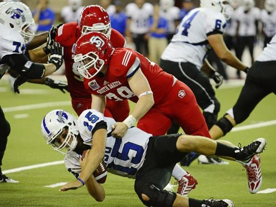 Roosevelt alum John Wessel will try to help USD escape the MVC cellar.