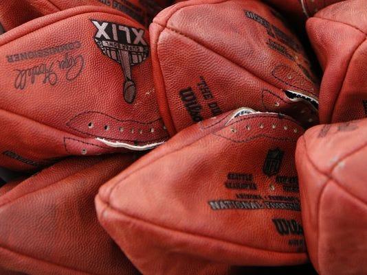 635774018022887696-635774011860744199-AP-Super-Bowl-Footballs-001