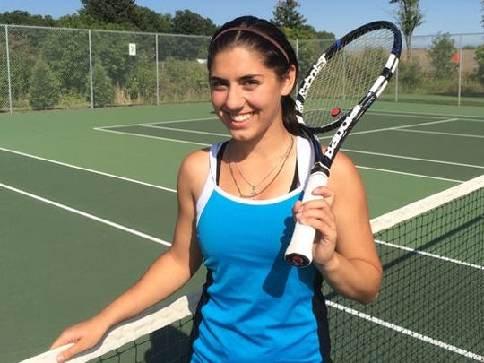 Ashwaubenon senior tennis player Meghan Tilot is featued