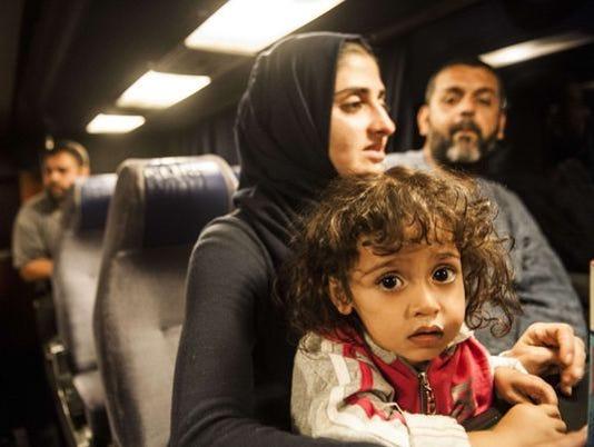 635786285974310550-syrian-refugee