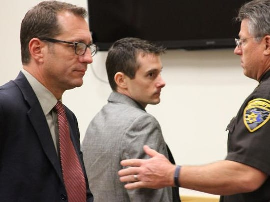 Anthony Sean Duke, middle, turns to his family after a jury convicted him Thursday of felony murder in connection with the Dec. 30, 2011, fatal shooting of an Iosco Township landscaper. Also pictured is defense attorney Rolland Sizemore, left, and Deputy Dave DeVries.
