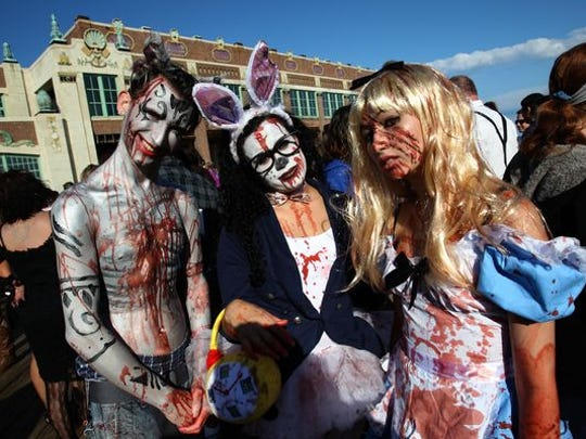 Participants of the Zombie Walk in Asbury Park make their way along the boardwalk last year. A new zombie walk will be held on Friday evening, Oct. 2, rain or shine, on Main Street in Boonton. (Photo: Daily Record file photo)