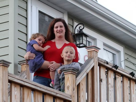 Laura Murray at home in the Highlands with her son Colin, age 6, and daughter, Gracie, age 2, Wednesday, October 21, 2015. The Murrays were forced from their home by Superstorm Sandy, when Laura was six months pregnant.