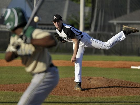 Matt Cronin pitches in a playoff game last season against Tallahassee Lincoln. Monday, Cronin signed to the University of Arkansas.