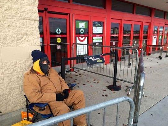 Charles Castor waits outside a Nashville Target store