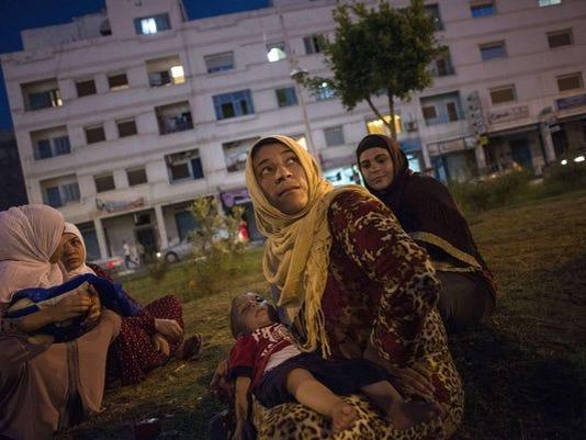 635847526645416779-refugees.jpg