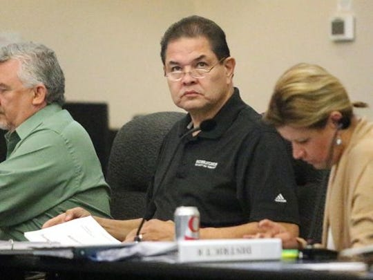 City Rep. Larry Romero, center, during a special council meeting earlier this week.