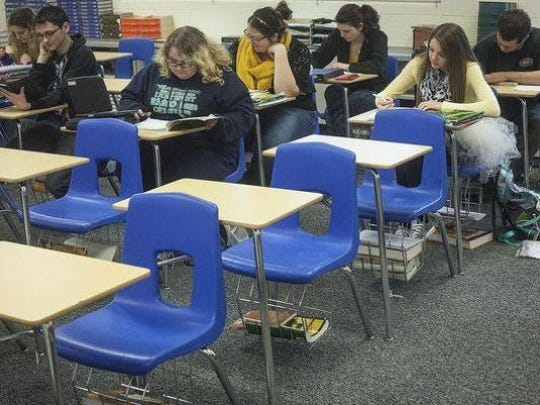 Students take notes during a class at Union Schools