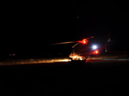 A Life Flight helicopter prepares to take off and help