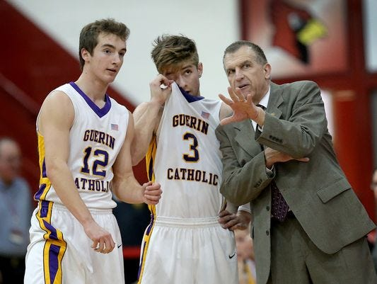 Guerin Catholic coach Pete Smith prays with his team before each game and that's OK. It's not a public school.