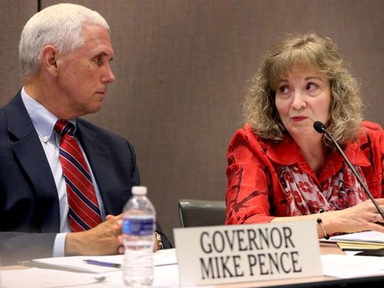 Republican Gov. Mike Pence and Superintendent of Public Instruction Glenda Ritz exchange opinions on June 23, 2014, days after Pence signed a bill into law that stripped much of the control of education policy away from Ritz, a Democrat.