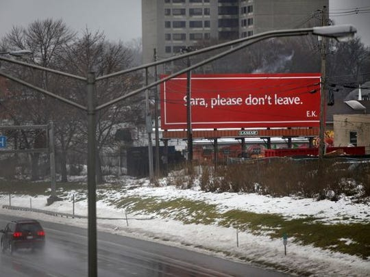 A man hoping to keep his girlfriend in the Rochester area had this billboard put up.