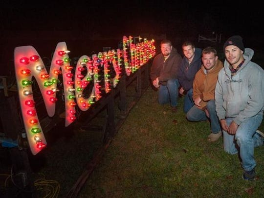 Wall Christmas Light Show organizers posing for a photo.