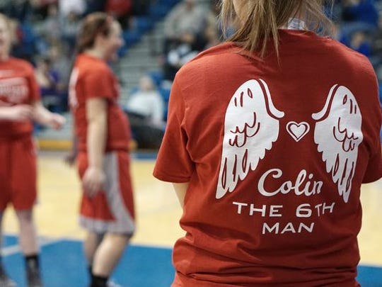 The Buckettes wore shirts honoring Colin before playing