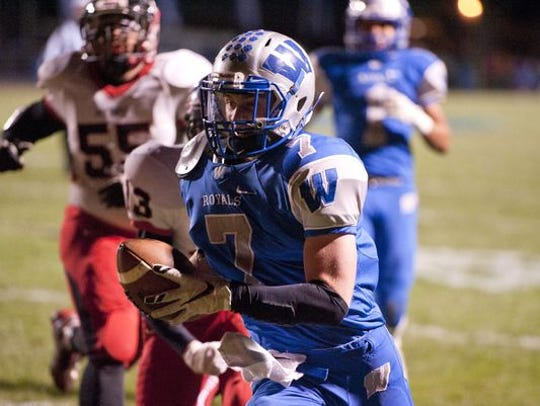 Nick Looker runs for a touchdown for the Royals in