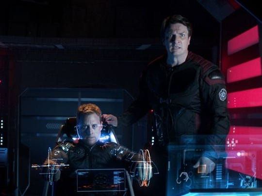 "Alan Tudyk (left) and Nathan Fillion in a scene from ""Con Man."""