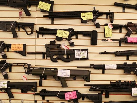 Weapons are seen on display at a gun store in Delray