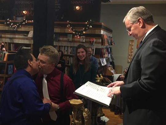 On his final day in office, Mayor Greg Ballard officiated the marriage ceremony of Juan Silva (left) and Jonathan Clifford, on Dec. 31, 2015.
