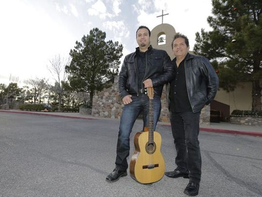 "Jorge Alvidrez, left, and Sergio Carmona co-wrote the song and lyrics for their song, ""Francisco Es,"" which will be the official song for Pope Francis' trip to Mexico in February. The pope is scheduled to make a stop Feb. 17 in Juárez. ""Misionero de la Misericordia"" (Missionary of Mercy) will be the slogan used for the pope's trip to Mexico. Carmona and Alvidrez stand outside Little Flower Catholic Church in El Paso's Lower Valley, where they will perform their song Sunday."