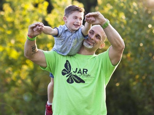 Jim Raffone holds 6-year-old son Jamsey.