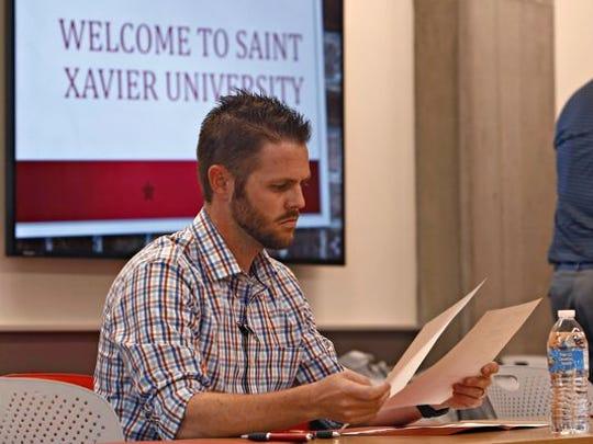 Ryan Schulte sits through orientation at the St. Xavier