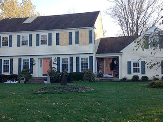 The Sheridans' Somerset County home was boarded up after a September 2014 fire. The couple was found inside, and their death was ruled a murder-suicide, but a powerful group of New Jerseyans doesn't want that to be the final word on the case.