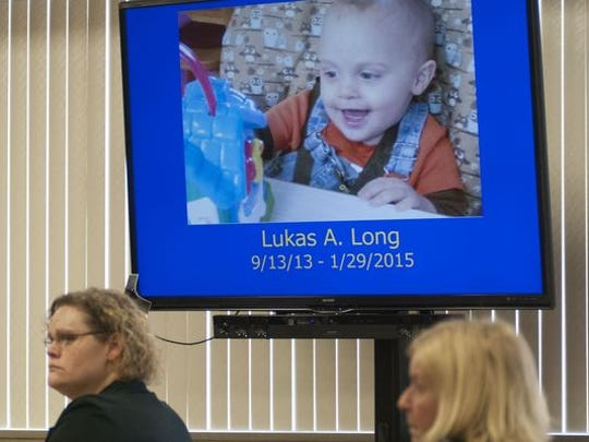 A photo of Lukas Long is displayed on a screen beside his mother, Elizabeth Long, during opening statements Wednesday, Feb. 17, 2016 in Circuit Judge Michael West's courtroom.
