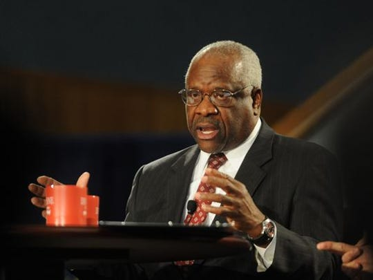 Supreme Court Justice Clarence Thomas addresses an audience during a program at the Duquesne University School of Law in Pittsburgh in 2013.