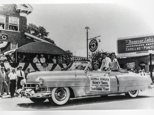Ronald and Nancy Reagan ride in a parade held in Springfield