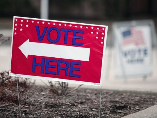 A sign directs residents to vote in the Michigan primary on March 8, 2016, in Detroit.