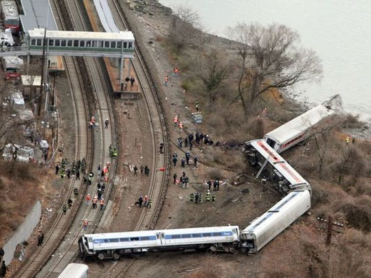 Emergency personnel at the scene of a Metro-North train