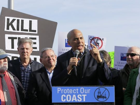 Sen. Cory Booker talks at a protest in January against offshore drilling.