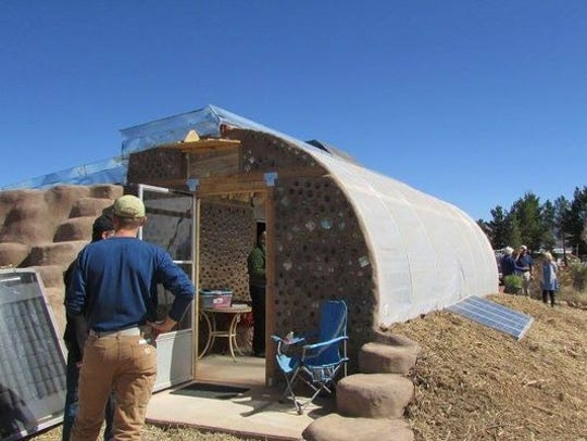 Otero County residents toured the completed Earthship