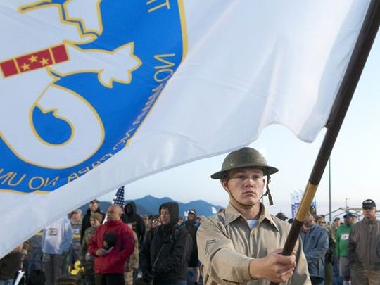 Cadet McCarty of Taos NM, is dressed in period attire and carries the Bataan Memorial Death March flag at opening ceremonies Sunday morning at White Sands Missile Range.