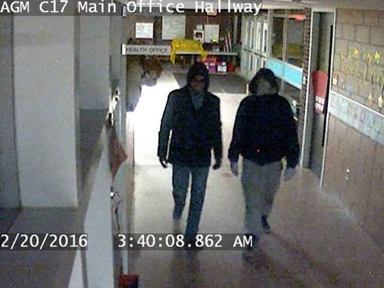 A footage from a security camera in Ann G. McGuiness Elementary school showing two burglars who have since been arrested for breaking into the school and stealing several items.