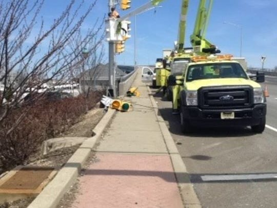State Department of Transportation crews repair traffic lights at the intersection of Eighth Avenue and Route 35 in Belmar after an accident on April 20, 2014, Easter Sunday, in which Tiffany Soto, 26, of Howell was killed.