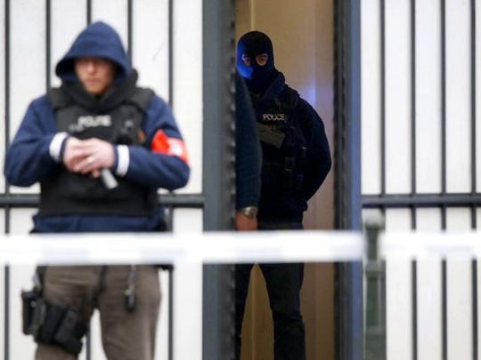 Police officers stand guard outside the court where a suspect in the Nov. 13 Paris terrorist attacks, Salah Abdeslam, who is not pictured, made an appearance, in Brussels. Photo was taken on March 24.