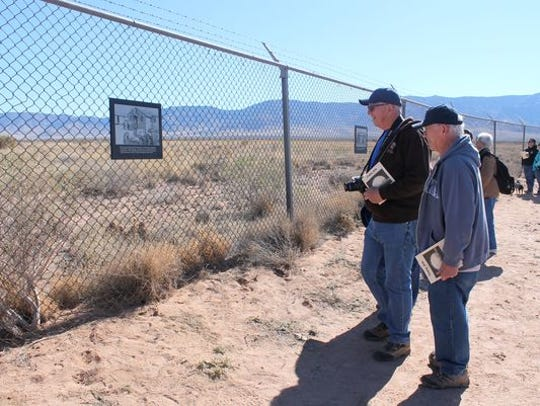 Visitors stop to read a plaque at the Trinity Site