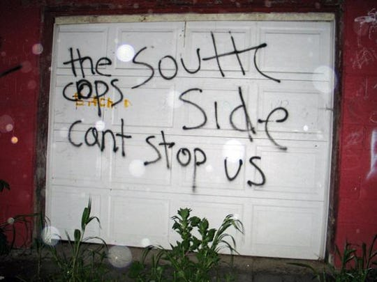 This Southside gang graffiti taunted law enforcement, but a joint investigation into Southside that led to federal indictments against 21 purported gang members disproved that taunting claim. (Photo courtesy of the U.S. Attorney's Office)