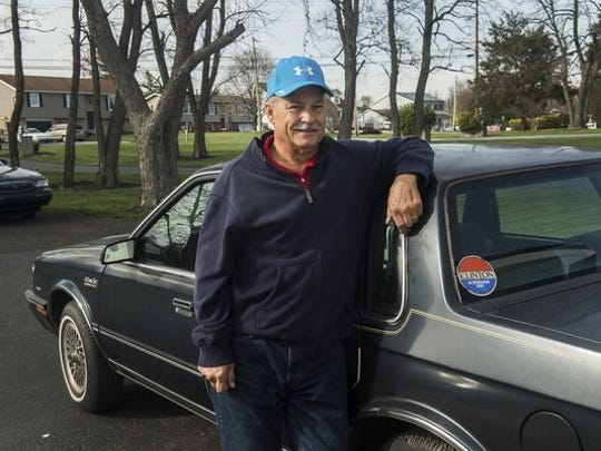 Gettysburg resident Mike Lawn stands next to the car formerly owned by Hillary Clinton on April 6, 2016.