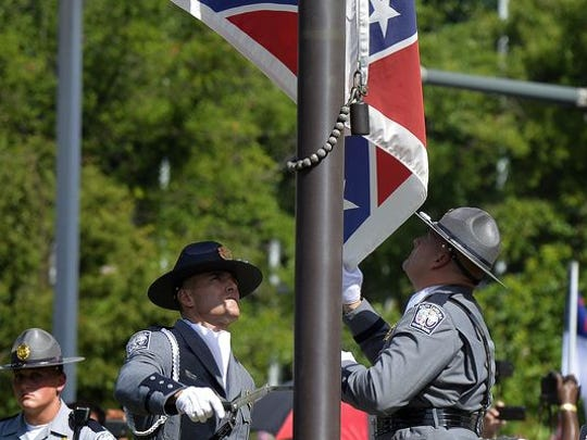A file photo of the Confederate Flag being taken down on July 10, 2015.