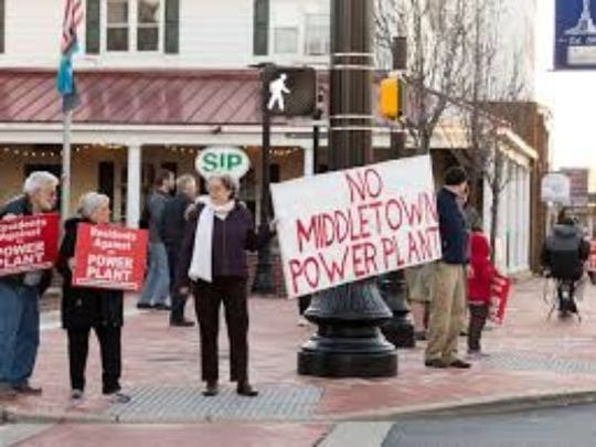People protest a proposed data center and power generator in Middletown in February. The state approved a $7.5 million infrastructure grant from the project Wednesday.