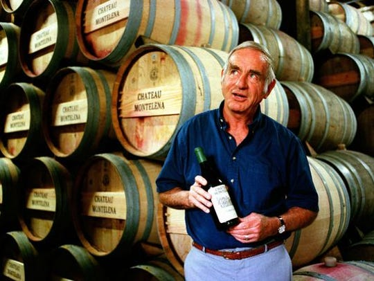 Jim Barrett, owner of Chateau Montelena, holds a bottle