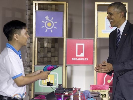 President Barack Obama tours a high-tech displays in an open work space at the DreamPlex Coworking Space in Ho Chi Minh City, Vietnam, May 24, 2016.