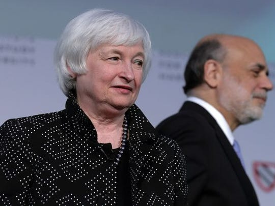 Federal Reserve Chair Janet Yellen is introduced by her predecessor Ben Bernanke, right, during a Radcliffe Day event at Harvard University in Cambridge, Mass., on May 27, 2016.