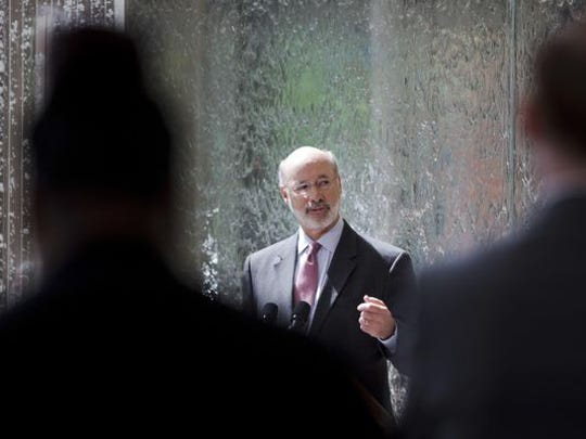 Pennsylvania Gov. Tom Wolf speaks during a news conference Thursday at the Temple University Lewis Katz School of Medicine in Philadelphia.