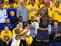 Cleveland Cavaliers forward LeBron James (23) shoots the ball over Golden State Warriors forward Andre Iguodala (9) during the third quarter in Game 1.