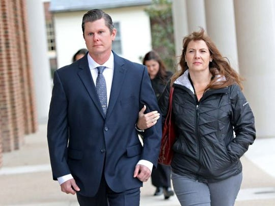 Dover police Cpl. Thomas Webster walks with his wife, Suzanne, into Kent County Courthouse on Nov. 29. Webster was accused of kicking a suspect in the head during an arrest. In May, his attorney called for an independent investigator to look into the Dover police internal inquiry into the matter.